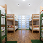 A room with many bunk beds